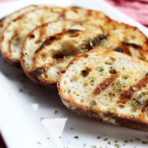 """Quid Pro Quo Butter Your Bread on Both Sides"" Grilled Garlic Bread"