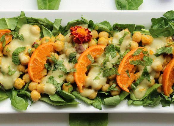 Clarity Chickpea Spinach Salad with Cumin Yogurt Orange Dressing.